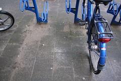 blue bike and bikestands