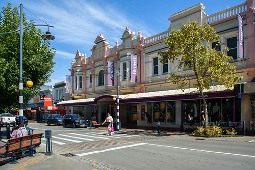 newzealand nikond750 southisland timaru buildings architecture trees sky clouds street road crossing shops seats bench cars people