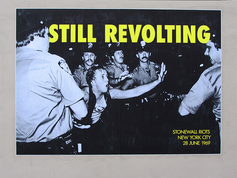 """stonewall riots police arresting a person with yello text """"STILL REVOLTING - Stonewall Riots New York City 28 June 1969"""""""