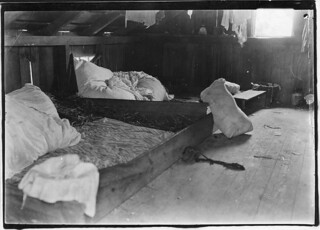 Interior of one family room on upper floor of one of the berry picker shacks, Bottomley's farm. Rock Creek, Md, June 1909