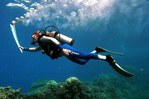 27 Jun 2000: Wendy Craig-Duncan carries the Sydney Olympic torch underwater at Agincourt Reef, Great Barrier Reef, Queensland, Australia. ©ROH/Allsport / Steve Nutt/ALLSPORT 2012   by Royal Opera House Covent Garden