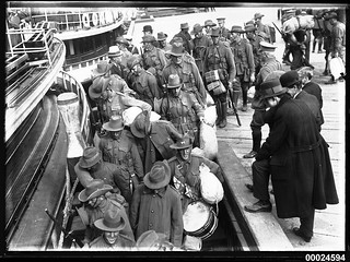 Australian troops boarding a ferry at a wharf in Sydney | by Australian National Maritime Museum on The Commons