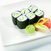 Small rolls with assorted vegetables or fish, with the nori on the outside. They generally contain only one filling, often tuna, cucumber, thinly sliced carrots, or avocado.