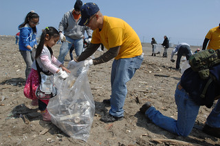 Sailors help gather trash at the Misawa Fish Port. | by Official U.S. Navy Imagery