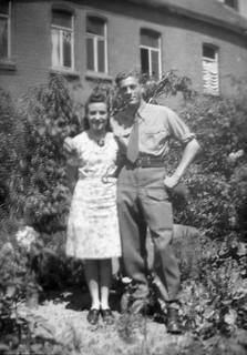 soldier posing with girl in garden