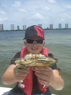 Casey holds a BIG blue crab. | by AdventureMIke.com