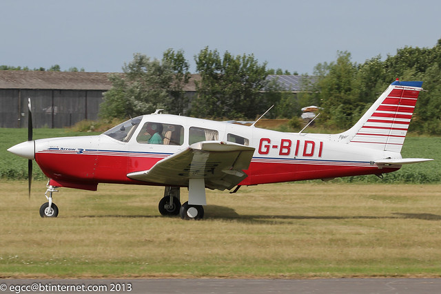 G-BIDI - 1978 build Piper PA-28R-201 Cherokee Arrow III, rolling for departure on Runway 29 at Breighton during Bücker Fest 2013