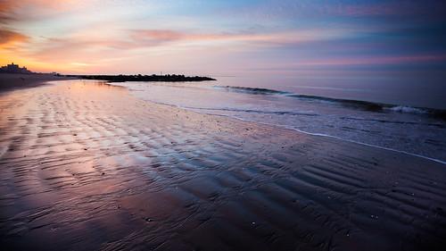 beach ocean waterfront water sunrise dawn colorful lowtide sand atlanticocean newyorkcity brooklyn outdoors