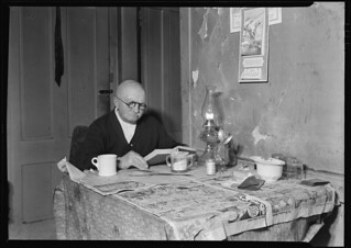 Living room and 78 year-old silk worker (now retired on $18 a month pension). Lives over Cafe, March 1937