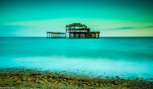 landscape seascape ruins pier brighton england uk fire damaged skeleton sea sunset sky colour glow beach seaside pebbles coast longexposure long exposure serene