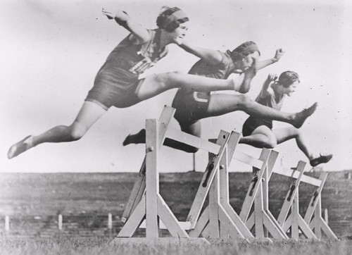 Women's hurdles race taking place at Sydney Sports Ground, New South Wales, March 1931. | by National Library of Australia Commons