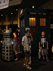 The Police Box and a Dalek from Doctor Who with a kid with a troll face