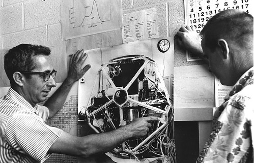 Taschek Richard with Jerry Connor and photo of Vela satelli | by Los Alamos National Laboratory