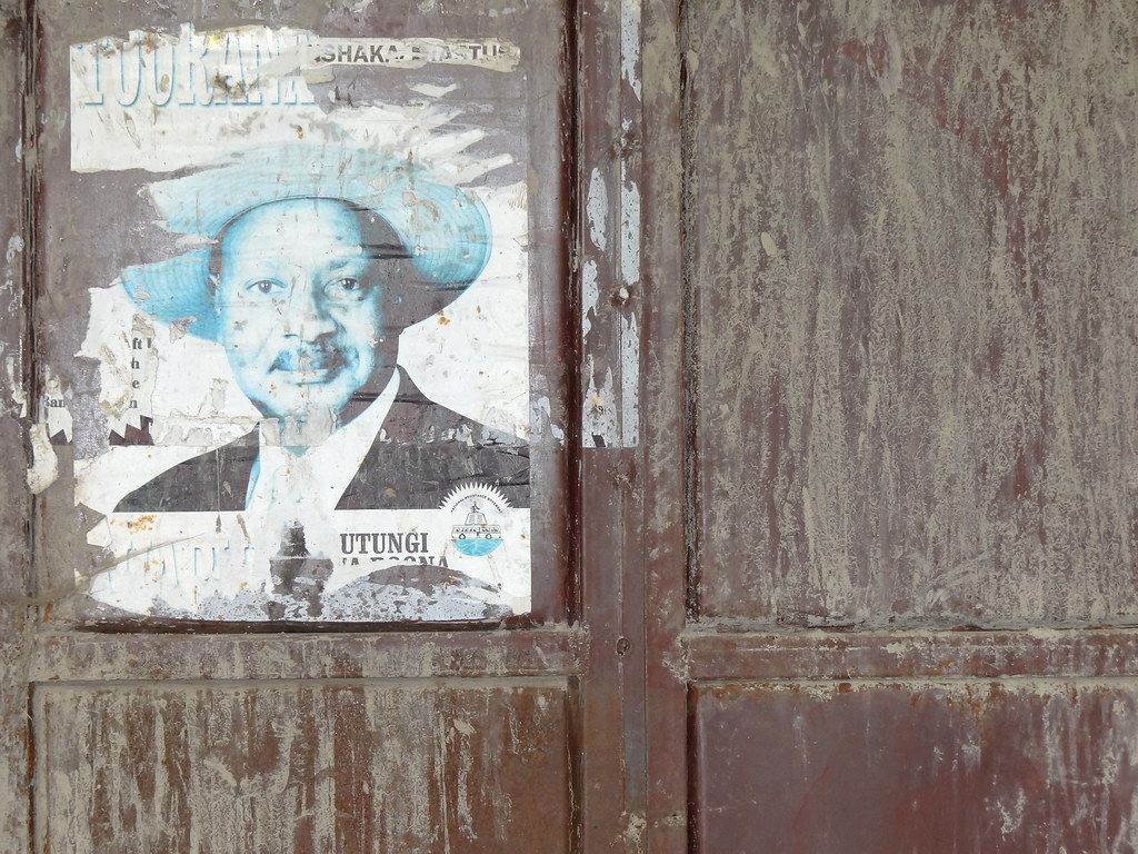 Facade with Poster of President Yoweri Museveni - Outside Kisoro - Southwestern Uganda