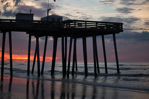dawn sunrise shore beach oceancity colorful old worn reflection sky clouds silhouette