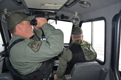 Photo of two NRP officers on boat patrol