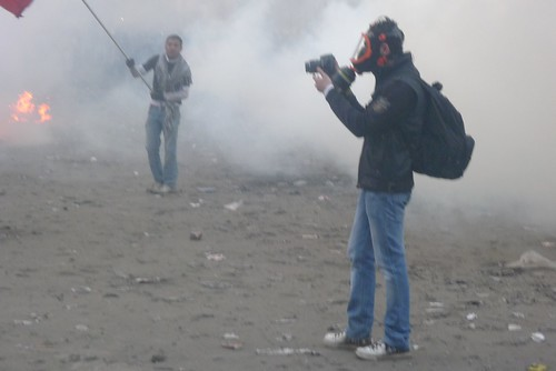Journalist wearing a gas mask on Mansour Street. | by alisdare1
