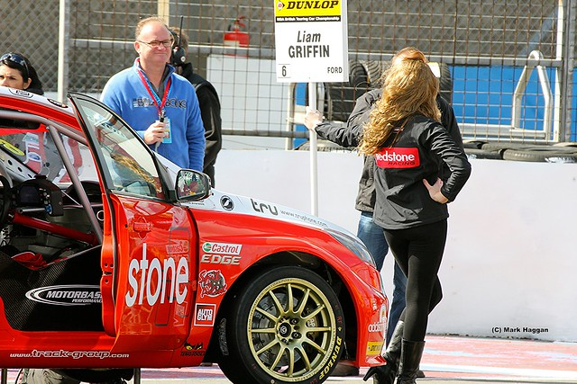 Liam Griffin on the grid during the BTCC at Donington Park in April 2012, with Gemma Newman holding the grid sign