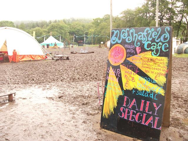 Buddhafield cafe sign and mud at Buddhafield Festival 2012