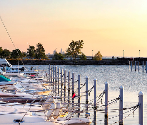 landscape water waterfront skyline boats outdoor evening lake lakeerie dock breakwater blimp downtown cleveland ohio