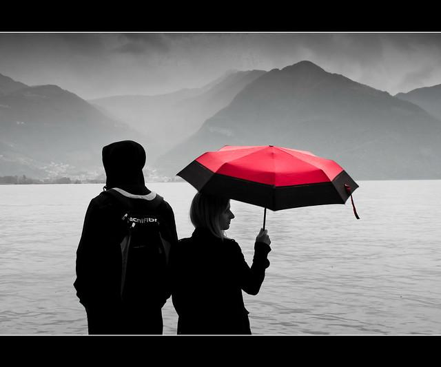 Lovere behind her red umbrella