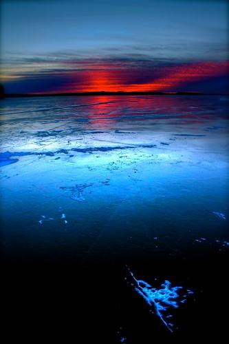 blue winter sunset red sun ice minnesota frozen purple smooth
