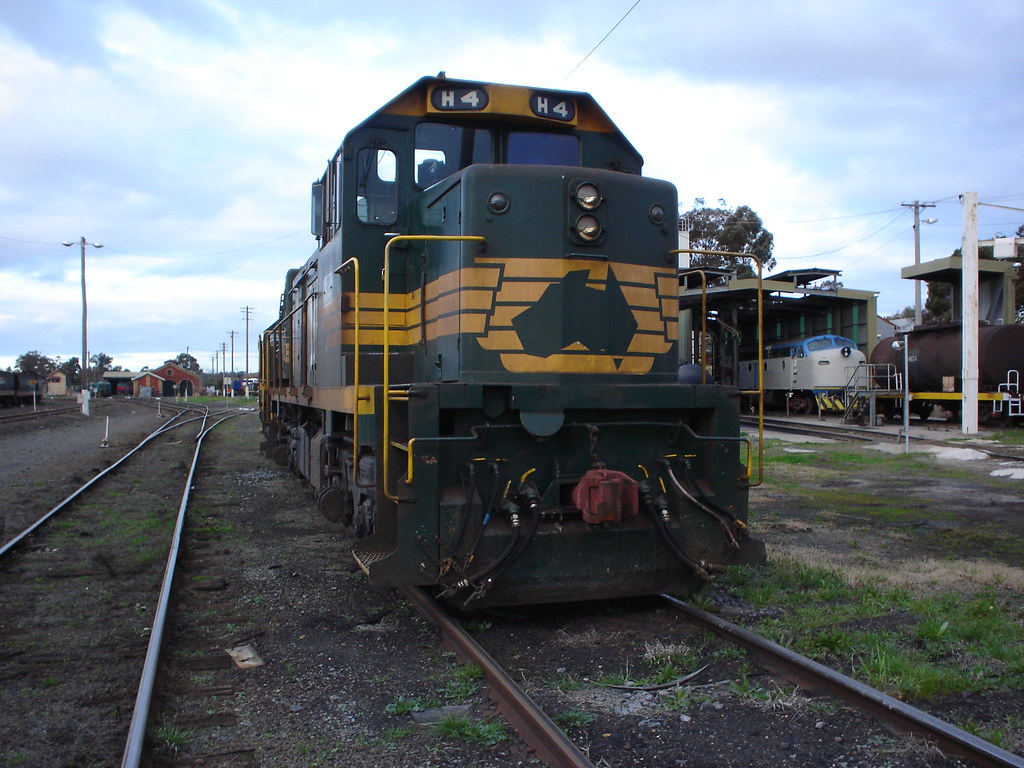 H4 in Bendigo with an ex WCR B or S class under restoration in the background by bukk05