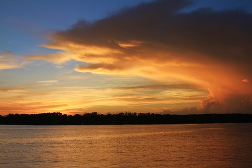sunset water clouds