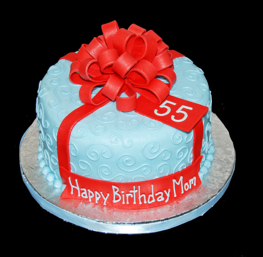Light Blue 55th Birthday Cake Topped With A Large Red Bow