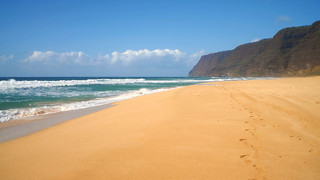 Sandy Beach with Mountains in Background   by StockPhotosforFree.com