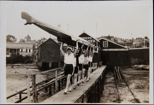 YWCA women's rowing team carry their boat from Gardner's Boat Shed   by Australian National Maritime Museum on The Commons