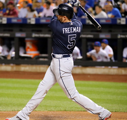 Braves first baseman Freddie Freeman swings at a pitch in the first inning. | by apardavila