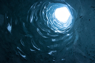 Hole in the roof to an ice-cave, Sólheimajökull glacier | by LimeWave Photo