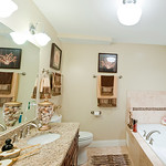Spa-days will be an everyday experience in this decadent bathroom featuring marble counters and a large soak tub.