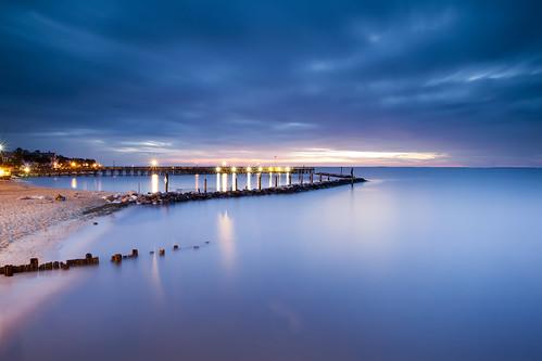 longexposure sunset beach clouds sunrise flow pier sand cloudy jetty smooth maryland northbeach pilings predawn breakwater chesapeakebay superlongexposure canon5dmkii singhrayrgnd ef1740f40lusm veryearlylight