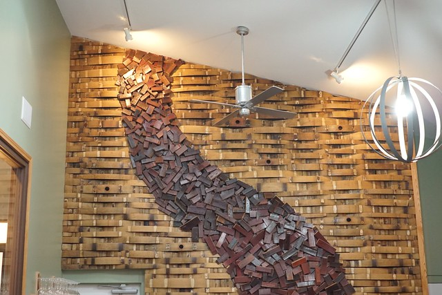 Wall decorated with wine barrel staves. Black Star Farms