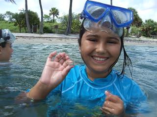 Julia catches a juvenile blue crab.