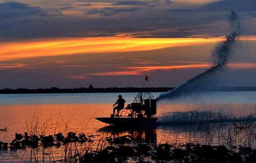 sunset sky sun lake water boat thegalaxy