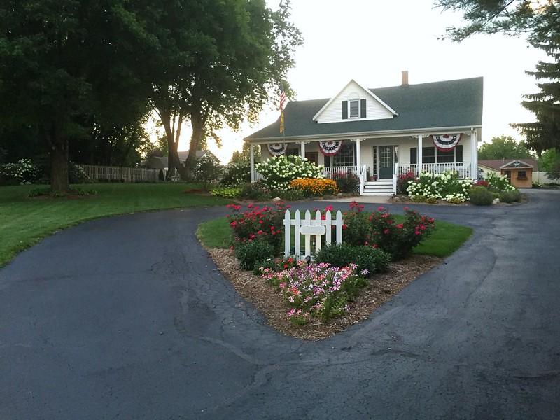 farmhouse with low-maintenance perennials