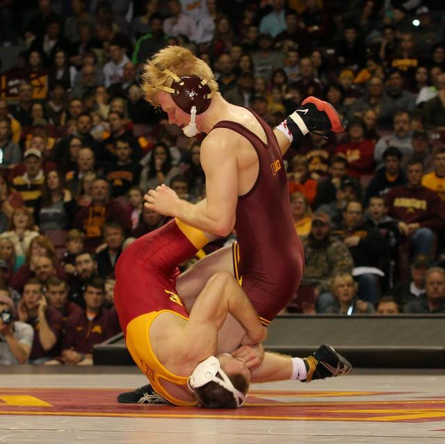 125 - Steve Polakowski (Minnesota) dec. Kyle Larson (Iowa State) 3-2. Photo by Mark Beshey.