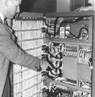 Physics Professor Jack Miller looking inside the Bendix G-15 computer