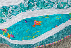 This fabric was the back of one of Jacob's quilts for his daughters. He gave me leftover backing fabric as a thank-you for helping him finish his presents for his girls.  Not only did the color work perfectly, but there were birds on it.  Quilt story is at domesticat.net/quilts/sea-and-sky
