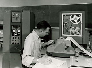 A student works with one of Pomona's first computers, the Bendix G-15, obtained in 1958.