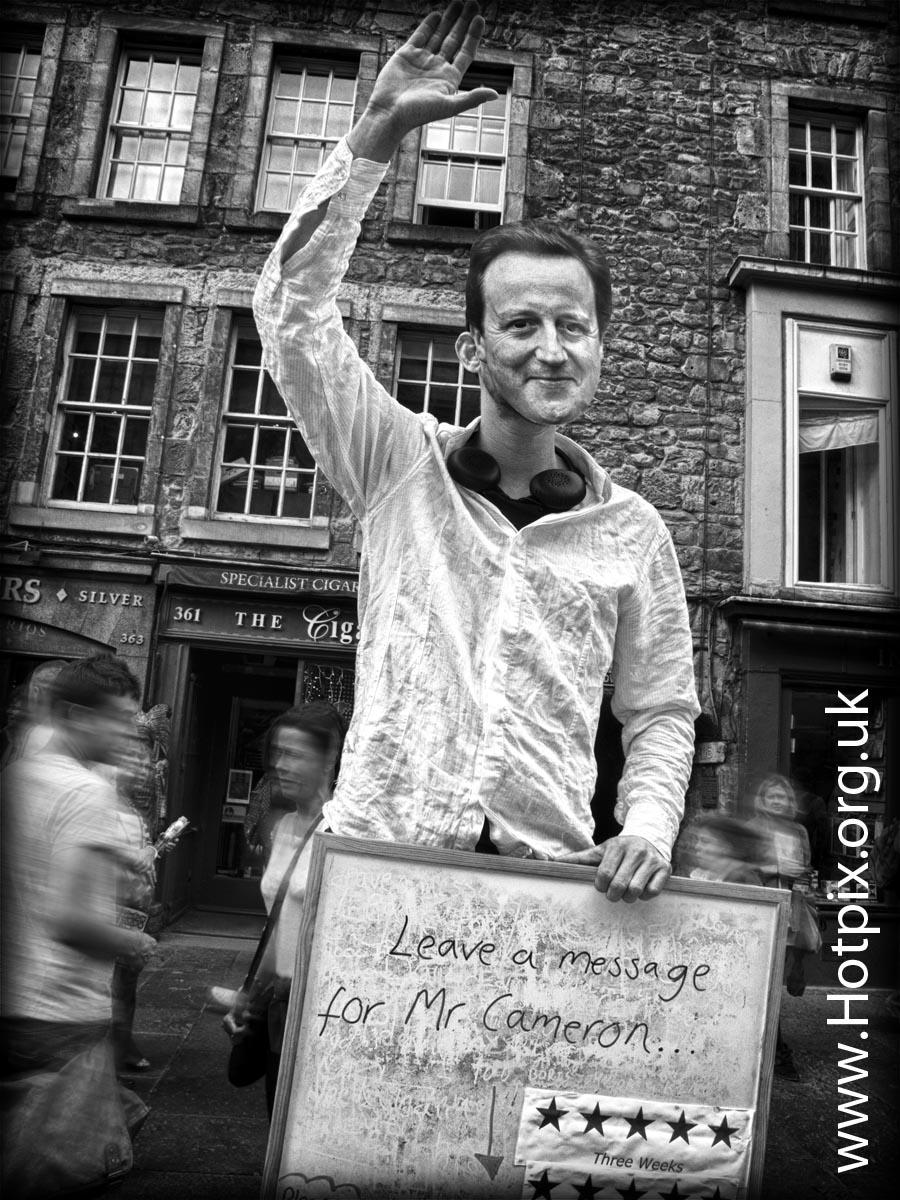 Davidcameron,David,Cameron,prime,minister,british,witney,MP,edinburgh,fringe,2012,fringe2012,leave,message,for,board,streets,Scotland,High,St,tattoo,August,festival,actor,performer,UK,city,tonysmith,tony,smith,hotpix,tonyhotpix,HDR,mono,b/w,black,white,vote,tory,tories,conservatives,caring,Dave,CaMoron,Davy