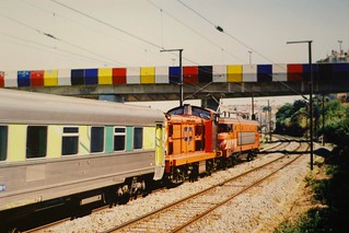 CP Portuguese railways 2620 and 1400 electric and diesel locomotives respectively hauling empty passengers stock, Vale de Chelas, Lisbon, Portugal