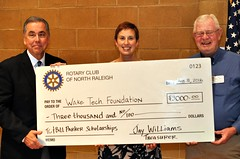 """A $3000 gift to the Wake Tech Foundation. R-L: Club President Scott Tarkenton, Stephanie Lake and Dr. Ed Smallwood who takes your BRAGGING DOLLARS AND SAVES THEM FOR US TO DONATE TO WAKE TECH.  More about this at <a href=""""http://northraleighrotary.org/club-50th-anniversary-project-bridges-to-success/"""" rel=""""nofollow"""">northraleighrotary.org/club-50th-anniversary-project-brid...</a>  Photo Credit: Gene Hirsch"""