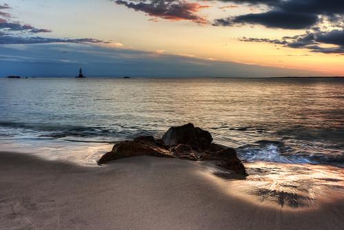 ocean light sunset sea lighthouse house beach water colors clouds sand rocks waves stones sakonnetpoint