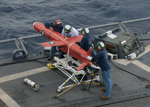 Team prepares drone for launch.