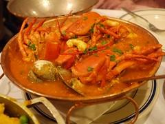 土, 2012-10-06 20:02 - Frutos do Mar na Cataplana Seafood simmered in a light tomato based sauce and served in a copper skillet in the appetizing southern style. Accompanied by rice.