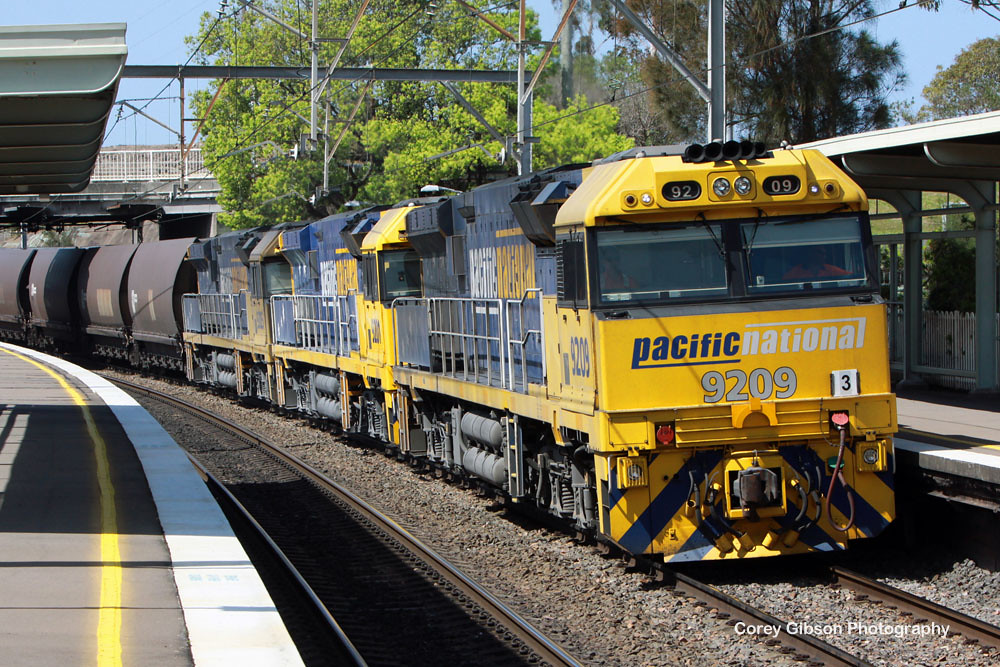 9209, 9201 & 9205 crawl through Cockle Creek Station by Corey Gibson